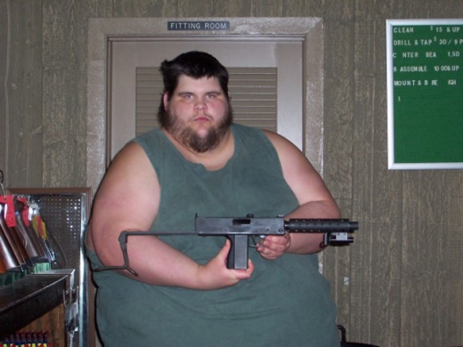 Fat Guy Shows Off Gun